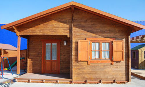 Casas de madera en portugal casa de madera reciclada en - Fotos de bungalows de madera ...